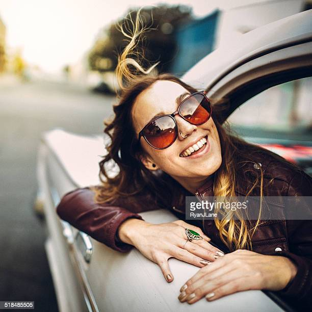 Happy Woman in Classic Car