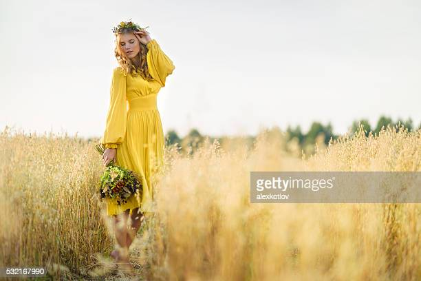 Happy woman in fields