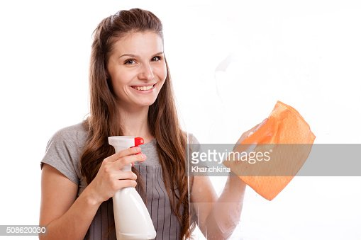 happy woman in gloves cleaning window : Stock Photo