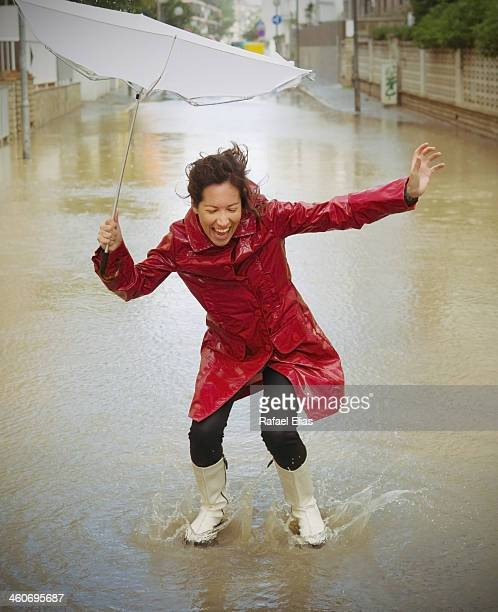 Happy woman in the rain