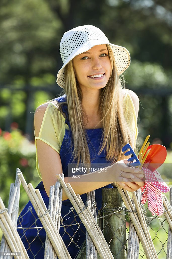 Happy woman  in uniform at yard gardening : Stock Photo