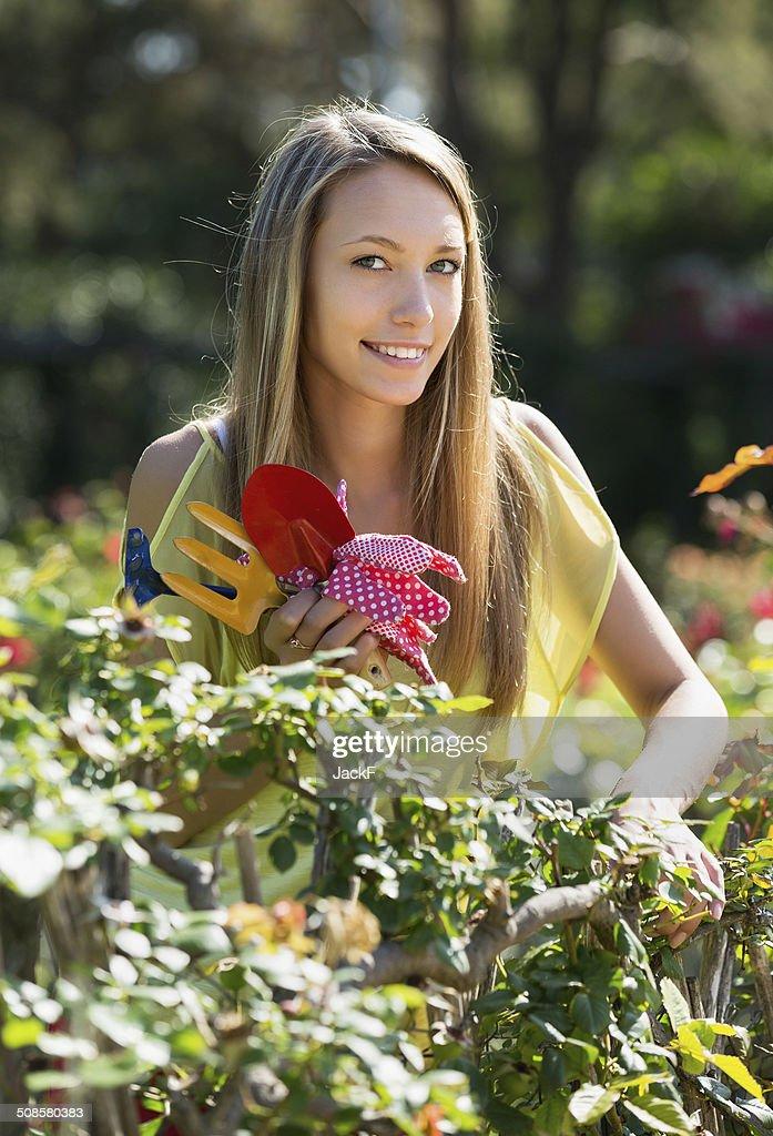 Happy woman in yard gardening : Stock Photo