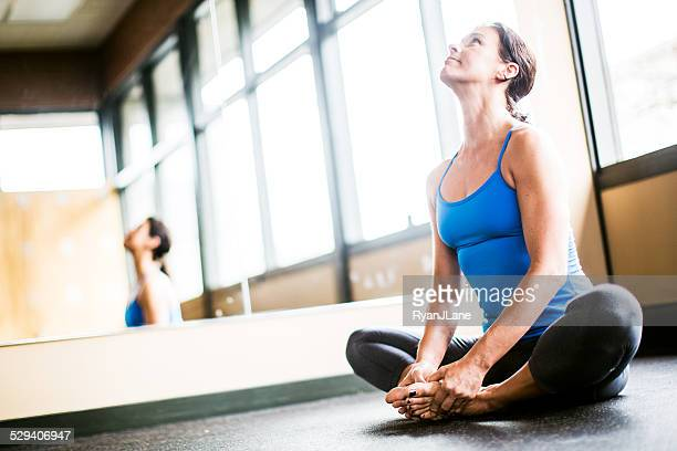 Happy Woman in Yoga Studio