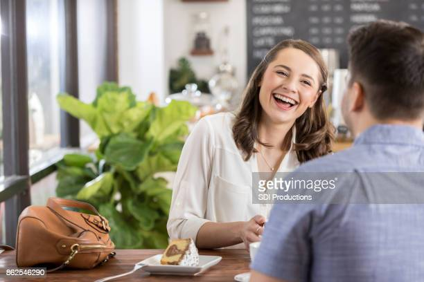 Happy woman laughs while on a date