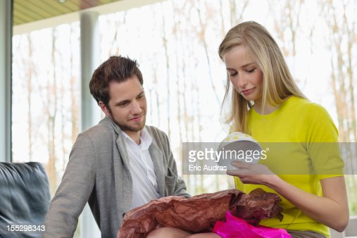 Happy woman looking at a present given by her boyfriend