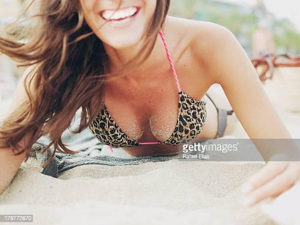Happy woman lying on the beach