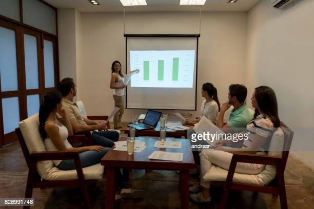 Happy woman making a business presentation