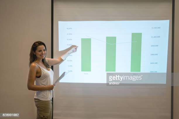 Happy woman making a presentation in a business meeting