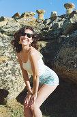 Happy woman near greek ruins