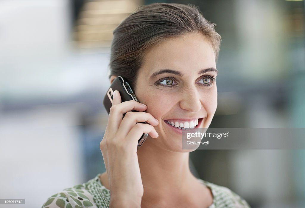 Happy woman on cell phone : Stock Photo