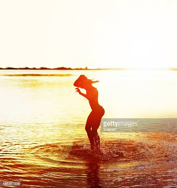 Happy woman on in the sea