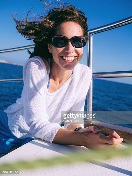 Happy woman on sailing boat