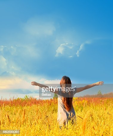 Happy woman on sunny meadow. Nature. : Stock Photo