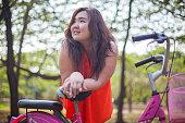 Happy Asian woman outdoor in park
