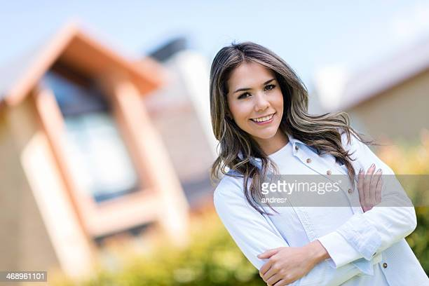 Happy woman outside her house