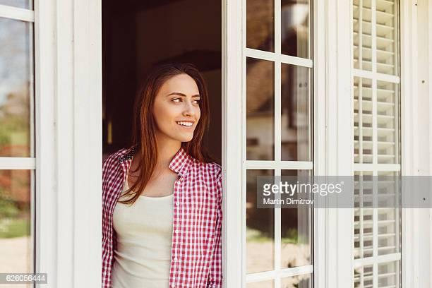 Happy woman peeking out