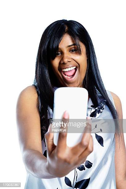 Happy woman photographing herself with mobile phone