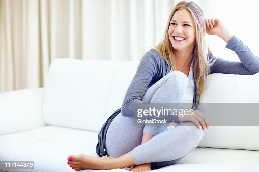 happy woman relaxing at home stock photo getty images. Black Bedroom Furniture Sets. Home Design Ideas
