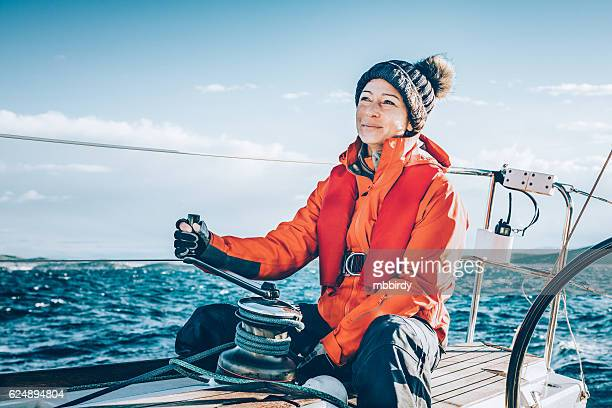 Happy woman sailing during regatta