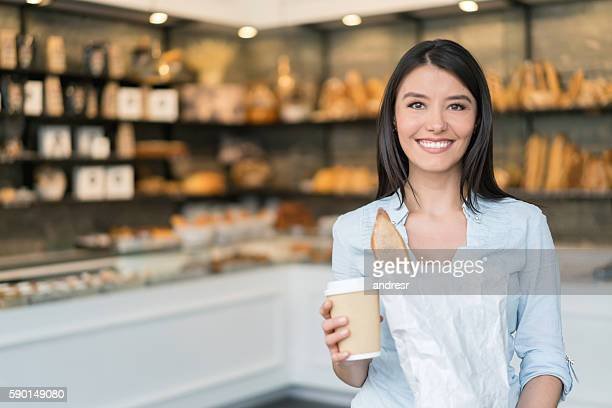 Happy woman shopping at the bakery