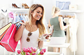 Picture showing happy woman shopping for shoes