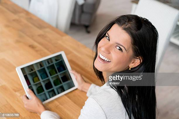 Happy woman shopping online on a tablet computer