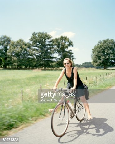 happy woman smiling riding bike  : Stock Photo