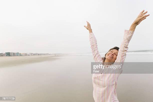 Happy Woman Standing on Beach
