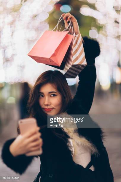 Happy Woman Taking Selfie With Shopping Bags