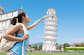 Happy woman travel in Italy, Leaning Tower of Pisa