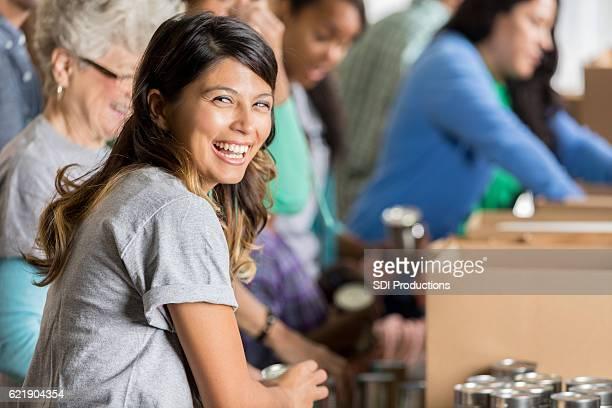Happy woman volunteers at a food bank