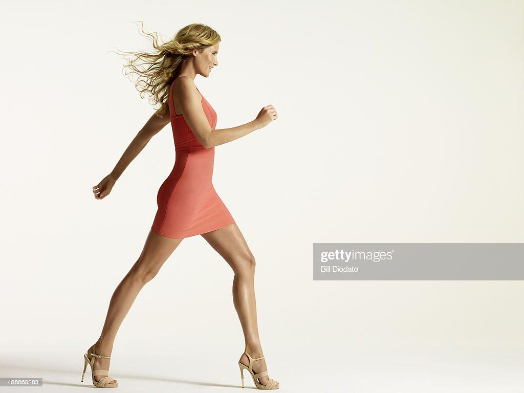 Happy woman walking in studio