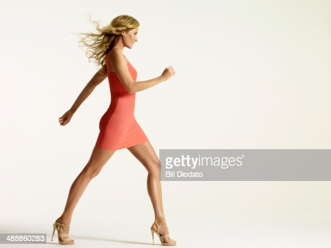Happy woman walking in studio