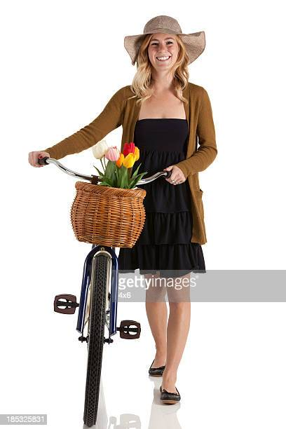 Happy woman walking with a bicycle