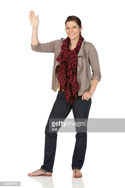 Happy woman waving hands