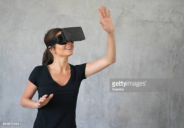 Happy woman wearing VR Glasses