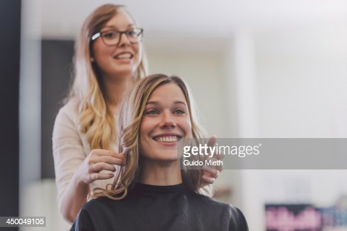 Happy woman with hairdresser