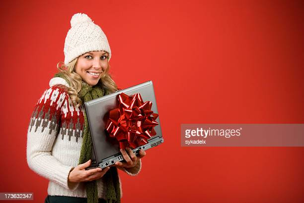 Happy Woman With Laptop Computer For Christmas