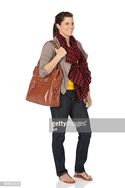 Happy woman with leather hand bag