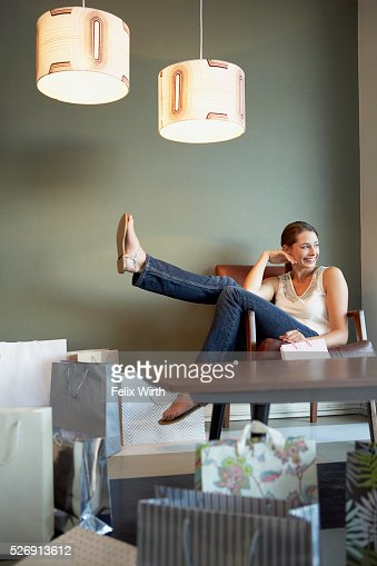 Happy woman with many shopping bags : Stock Photo