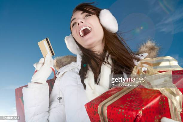 Happy woman with shopping bags and credit card