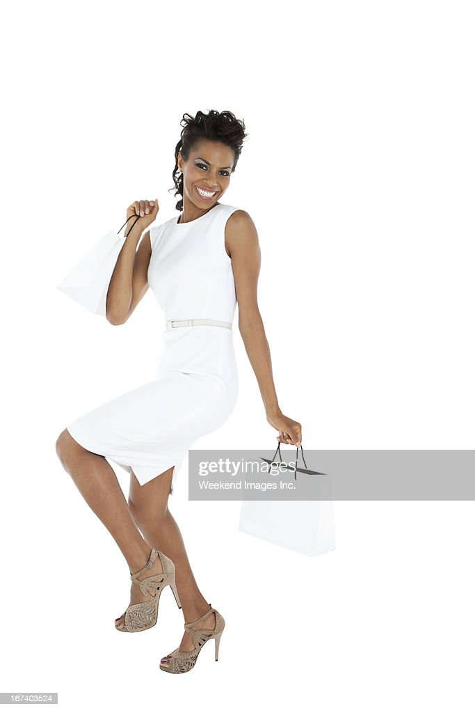 Happy woman with shopping bags : Stockfoto