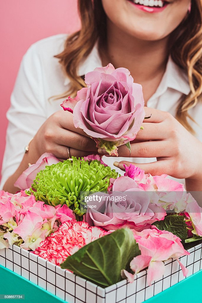 Happy woman with valentines flowers gifts : Stock Photo
