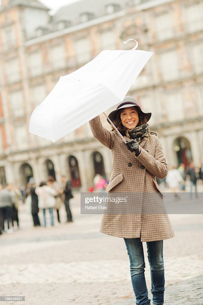 Happy woman with white umbrella : Stock Photo