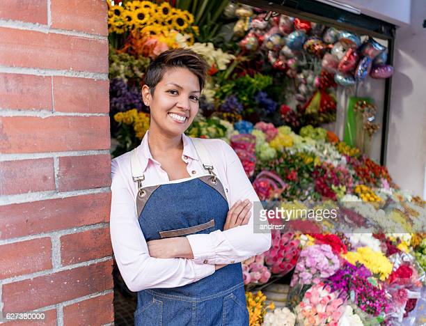 Happy woman working at a flower shop