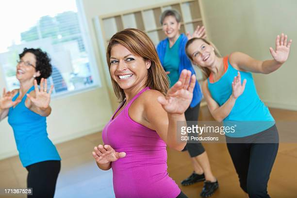 Happy women dancing in exercise class