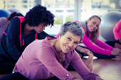 Happy women exercising in fitness studio
