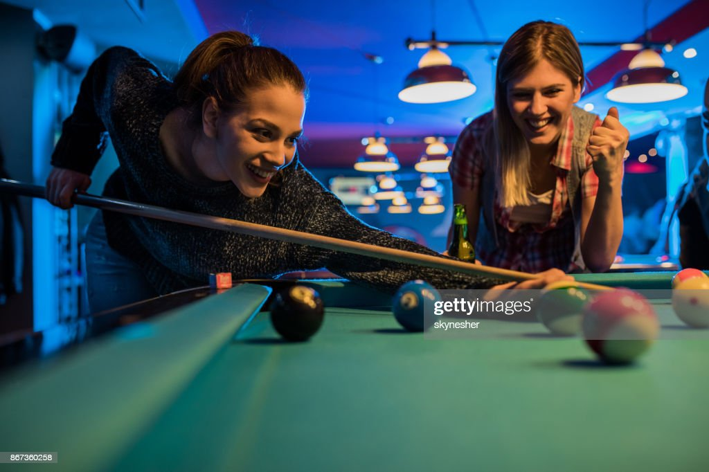 three ladies are playing billiards and having unforgettable threesome  24019