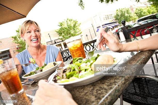 Happy Women Having Lunch Together on Outdoor Patio