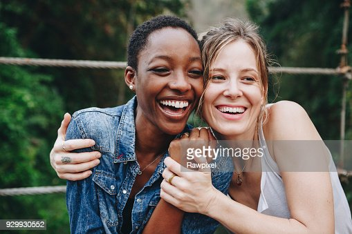 Happy women hugging each other : Stock Photo